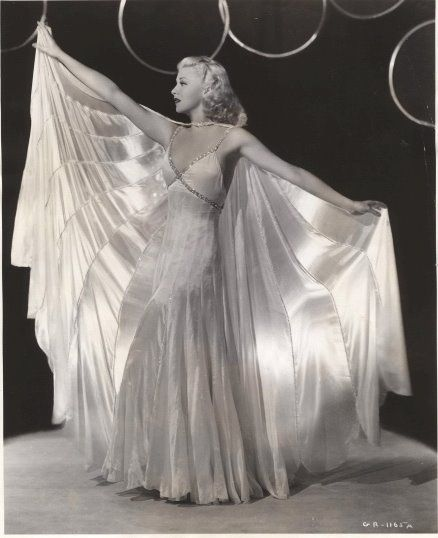 "Ginger Rogers wearing the stunning dress and cape combo for the number  ""Never Gonna Dance.""  The movie is  ""Swing Time"", 1936.  Gown designed by Bernard Newman.:"