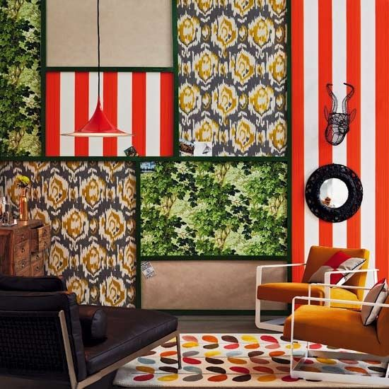 Bold living room  A mix of Seventies-inspired wallpapers in sectioned off panels create an art gallery feel to this vibrant living room. The miss green paint used to divide the papers helps to give definition.