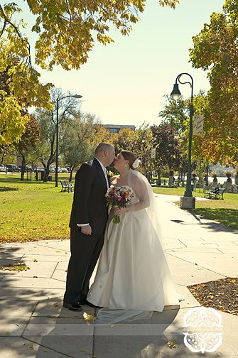 The fall leaves frame this picture of a wedding kiss nicely.