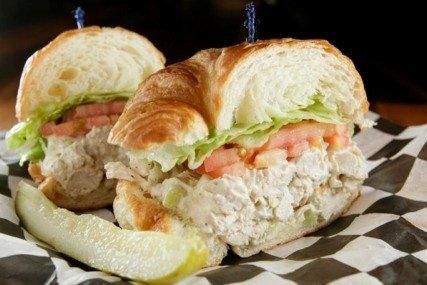 Chicken Sandwich Sandwich, with Huey's homemade chicken salad, lettuce, and tomato, on a buttery croissant