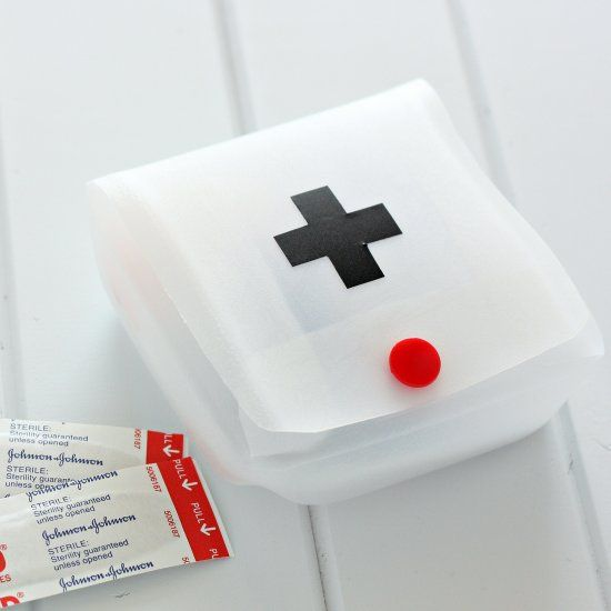 Make a quick first aid kit by cutting a recycled milk jug and attaching a snap closure and vinyl cross.