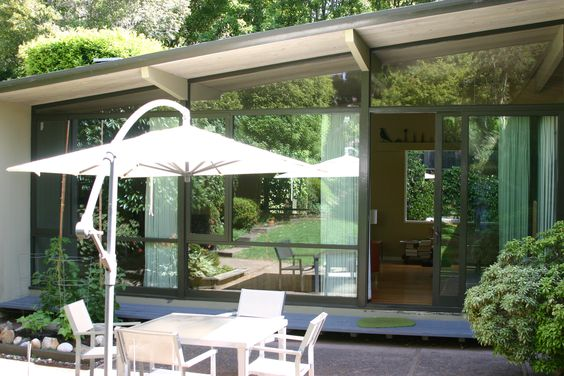 Mid-Century Modern windows, updated for sun and sound yet still looks original to house.
