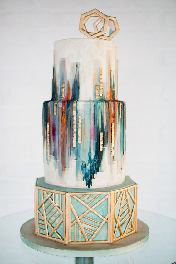 This awesome geometric cake with gold accents. | 25 Incredibly Beautiful Wedding Cakes That Won 2015: