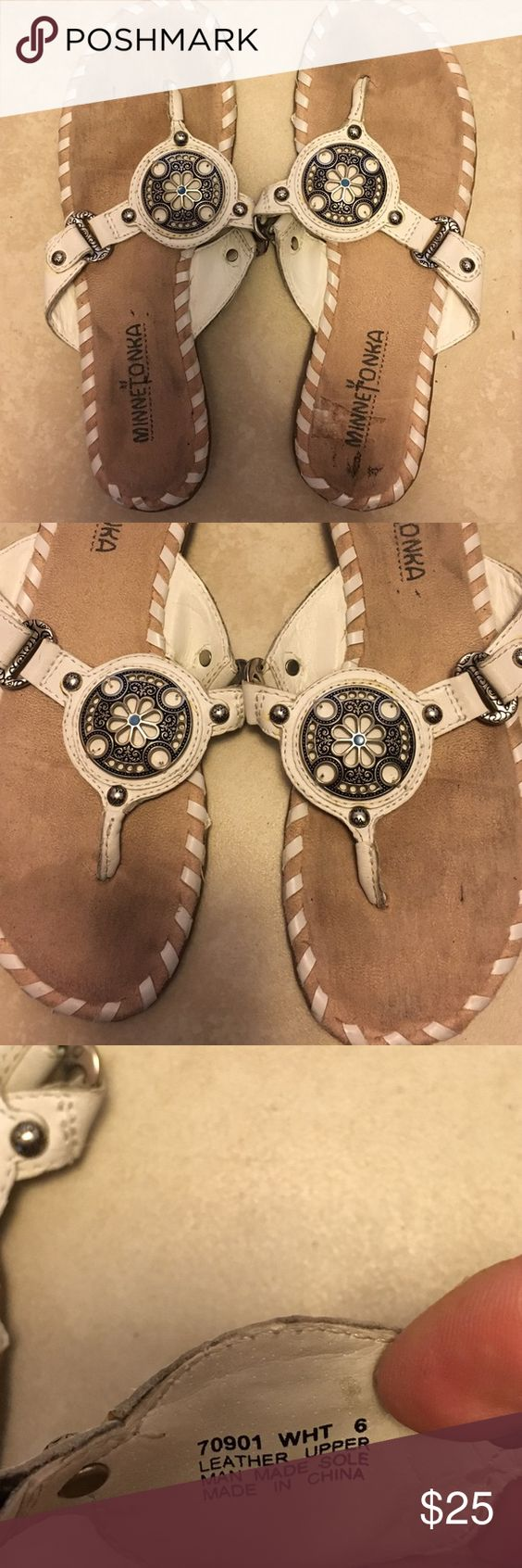 White with silver detailing Minnetonka sandals GUC Minnetonka sandals in white leather and silver detailing. Center medallion with flower has turquoise detail. Style # 70901. Suede insole rubber sole. Item will he cleaned prior to shipping. Minnetonka Shoes Sandals