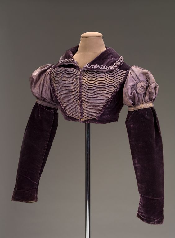Eggplant-purple velvet and purple silk twill spencer, about 1818, from the DAR Museum, Washington DC. From the (John and Abigail) Adams family, possibly worn by a granddaughter.:
