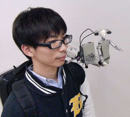 A robot that sits on your shoulder, wants to be your friend, interacts with your daily explorations.