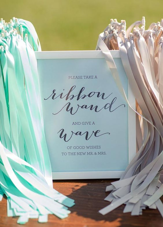 8 Amazing Wedding Exits: Add a dash of fun and flair to your exit with ribbon wands waving through the air in your wedding colors. http://www.colincowieweddings.com/inspiration-and-details/8-amazing-wedding-exits/