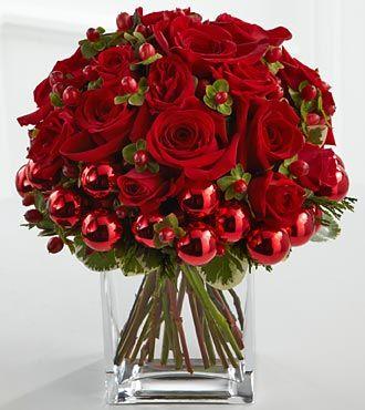 flores rojas y blancas con bolitas plateadas.. se vería muy bien!!