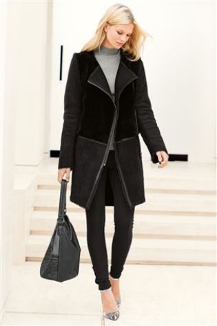 A real investment piece this black sheepskin coat from Next goes