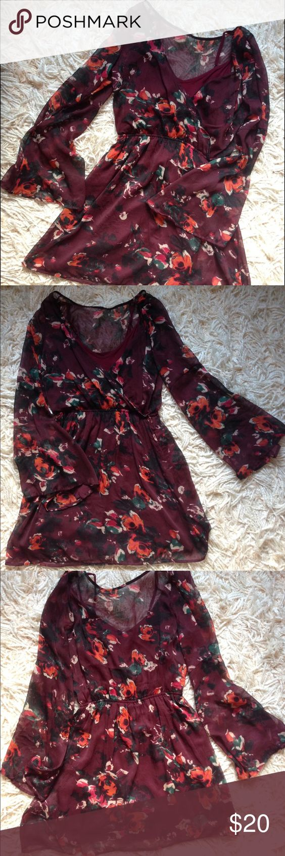 Abercrombie & Fitch flowery dress Maroon and multi color flowers. Very flowy with wide arms, would make for a great fall/spring dress! Abercrombie & Fitch Dresses