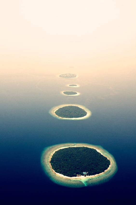 """Islands in the mist""... group of islands in the Maldives"