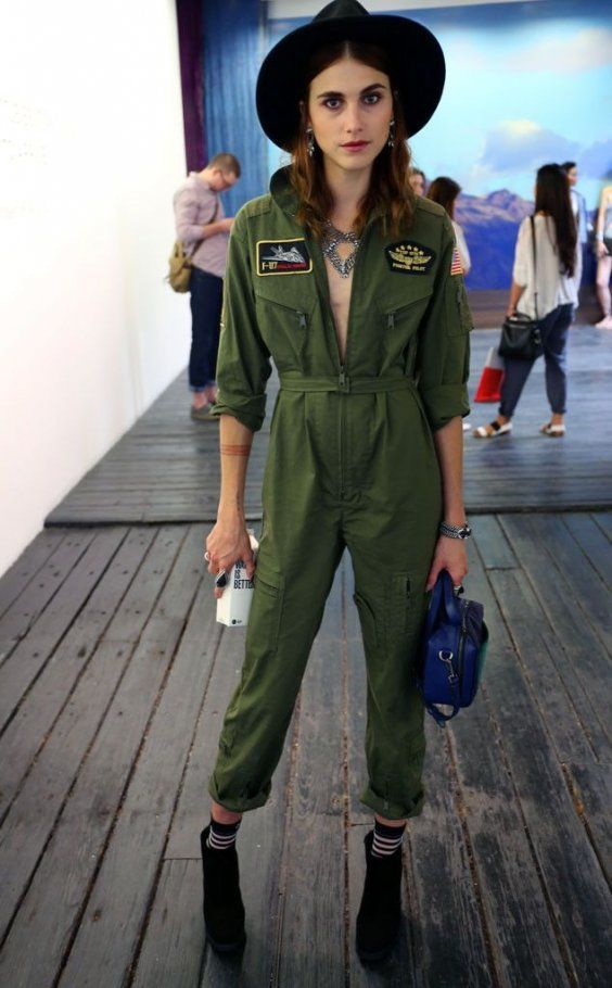 Black Ankle Boots and Hat is matched with this Utility Khaki Jumpsuit for a awesome Street Style Look