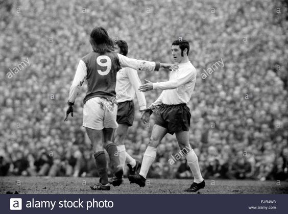 29th February 1972. Arsenal's Charlie George pushes away Derby full back John Robson in a  F.A. Cup 5th Round Replay at Highbury.