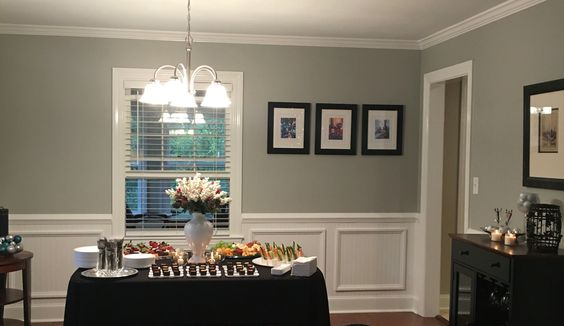 Client Project - Dining Room update featuring custom wainscoting and Personalized Framed and Matted Art & centerpiece by Bella Decor and Design.