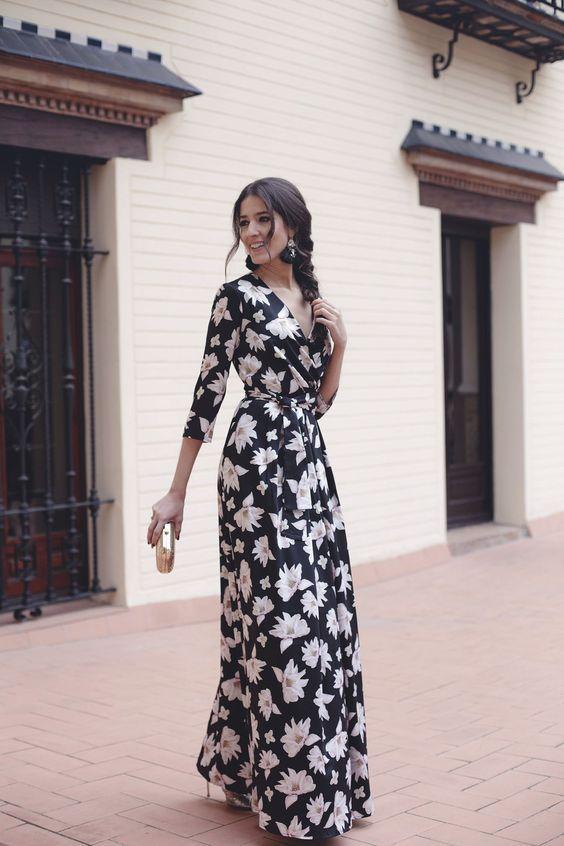 A Black Floral Maxi Dress With Long Sleeves And A V Neckline Black Tassel Earrrings Me Wedding Guest Outfit Fall Wedding Guest Outfit Black Floral Maxi Dress