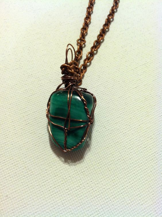 gorgeous green natural stone wrapped in copper color wire with copper color long chain.. $25.00, via Etsy.