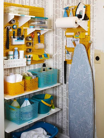 A pretty take on the utility closet. Make short work of cleaning by storing items in easy-to-transport caddies in a central location. To avoid sticky puddles of detergent or drips of bleach on shelves, place bottles in inexpensive plastic baskets or on top of plastic plant trays. Use a pegboard system to hold sewing-repair gear as well as ironing essentials.: