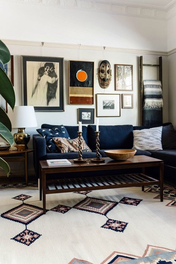 It's impossible not to appreciate the eclectic mix of art on this living room gallery wall!