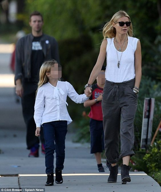 Conscious uncoupling: Gwyneth and Chris are parents to Apple, eight, and Moses, six... http://dailym.ai/1filtzp#i-ac1e0e8c