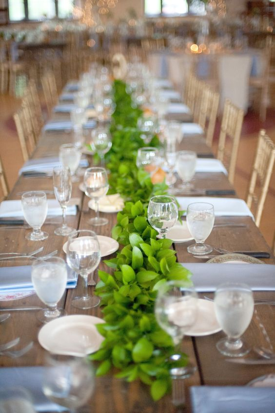 Wedding Styling - Greenery #Garlands running the length of the table! Hope it stays in vogue! | See the wedding on SMP -- http://www.StyleMePretty.com/2013/11/13/minnesota-wedding-from-emily-steffen-photography/ Emily Steffen Photography: