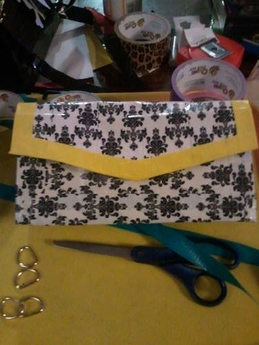 black, white, and yellow duct tape purse