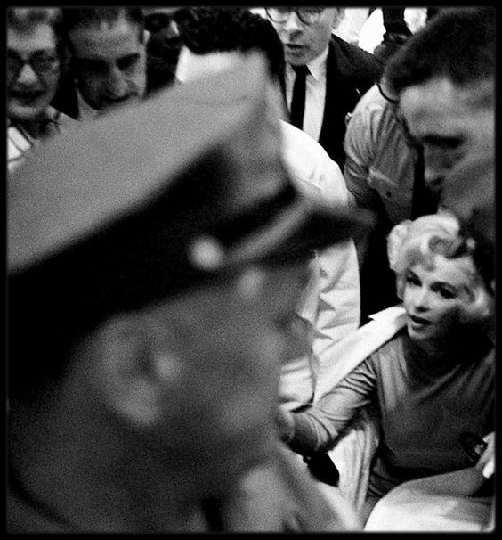 Marilyn surrounded by the media while leaving the Polyclinic Hospital after gallbladder surgery, July 11, 1961.