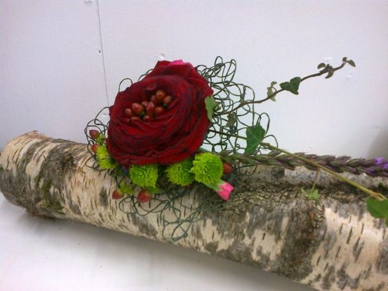 Sarah Tuhill, placed Hypericum Berries inside a carmen rose.