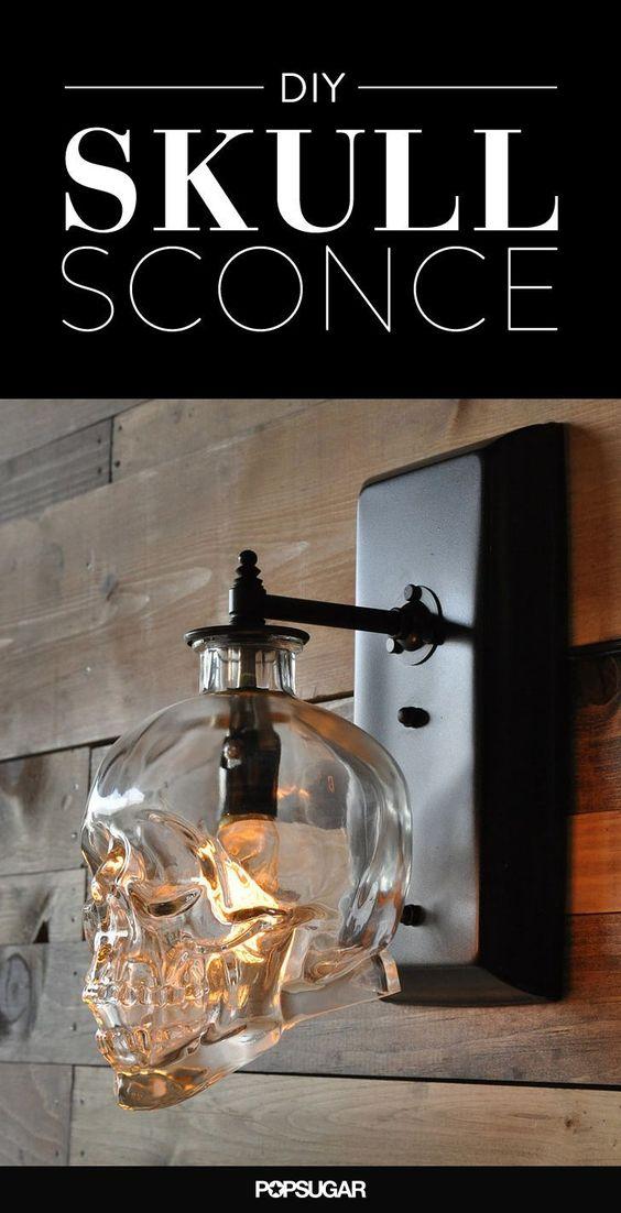 DIY skull sconce made from liquor bottle
