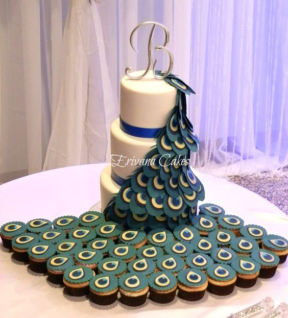 Peacock Themed Wedding cake - This is a peacock wedding cake that I made for a wonderful couple that cascaded into cupcakes!