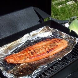"""Grilled Salmon I  """"A simple soy sauce and brown sugar marinade, with hints of lemon and garlic, are the perfect salty-sweet complement to rich salmon fillets. Even my 9 year old loves this recipe!""""    This Kitchen Approved Recipe has an average star rating of 4.8 Read Reviews (2,114)"""