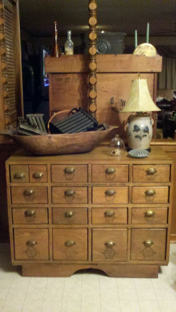 Hardware store cabinet, candle molds