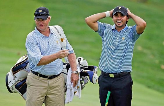International team player Jason Day, right, of Australia, laughs with his caddie Colin Swatton during a practice round for the Presidents Cup at Muirfield Village Golf Club