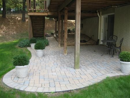 Patio under deck...this one is nicely done using stone/bricks instead of a cement patch