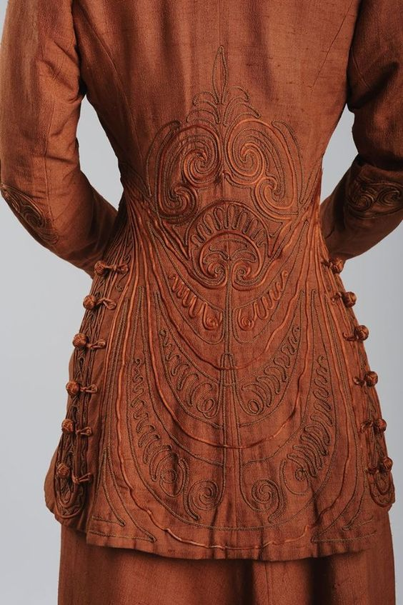 """""""Suit, Ludwig Zwieback & Bruder, Vienna, ca. 1908. """"This dress, with its bolero-styled jacket, longer back, and passementerie, is an example for the much quoted """"Wiener Chic"""" [Vienna Chic]."""""""