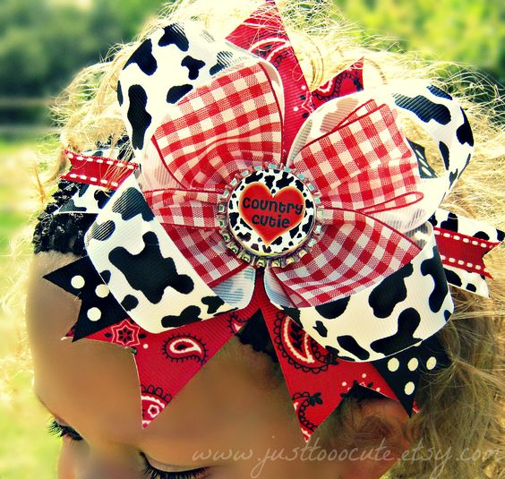 Country Girl Bottlecap Boutique Bow in Cow print & Red Gingham i really don't like the bows that are as big as the kid's head but this one is cute.