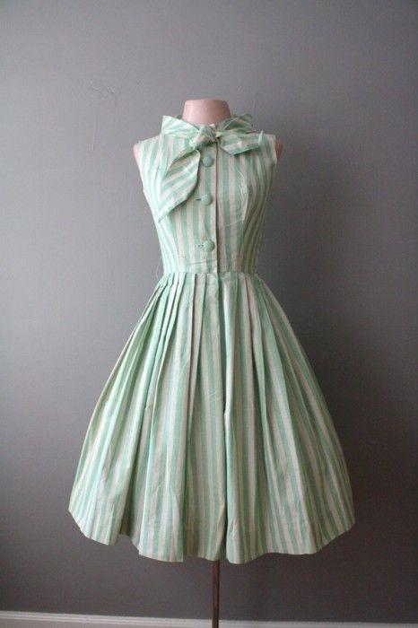 Pinstripe, plus bow, plus full skirt, plus light green, plus button up equals adorable.