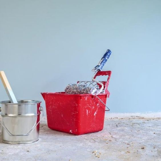 Painting concrete basement walls in a light, cool color brighten the room and make it look bigger.