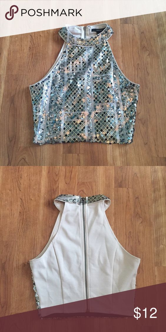 High neck sparkly crop top Really cute crop top to wear anytime of year! Wore it nye last year and it rocked Forever 21 Tops Crop Tops