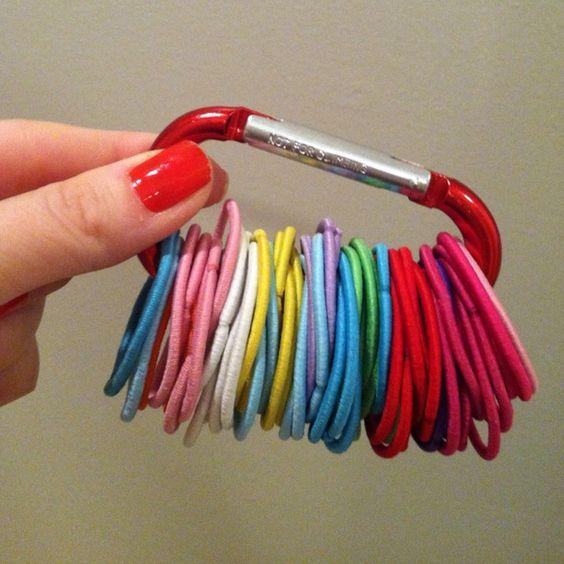 hair ties organized on a caribeaner