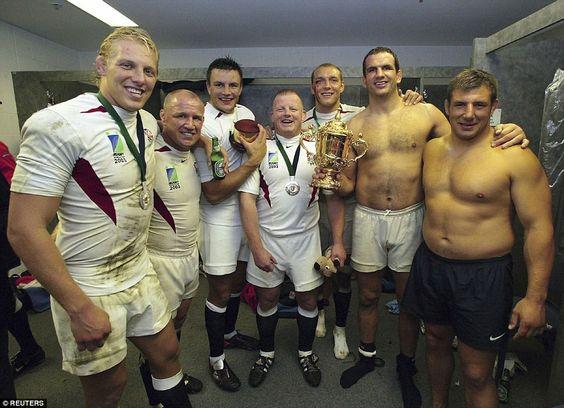 England forwards Lewis Moody, Neil Back, Martin Corry, Dorian West, Ben Kay, Martin Johnson and Julian White celebrate winning the…