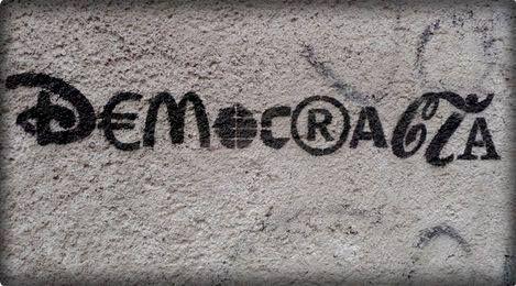 """Arte Callejero (Street Art). La Democracia y el Capitalismo Está Demostrado Que No Es la """"Mejor Forma de Gobierno """" y Que No Tiene Que Ser Resuelta Por Bajar Nuestros Estándares y Aceptar..."""