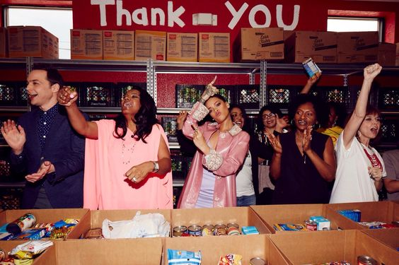 """The stars of """"Home"""" held a red carpet premiere for contest winner Cheryl Jackson at her food pantry."""