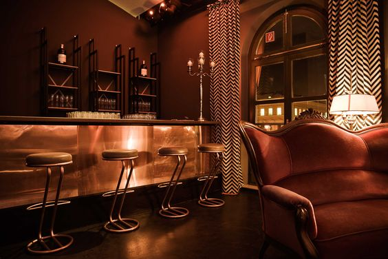 LAZY MOON München. Design by NOVONO. bar copper surfaces. zigzag curtains custom printed