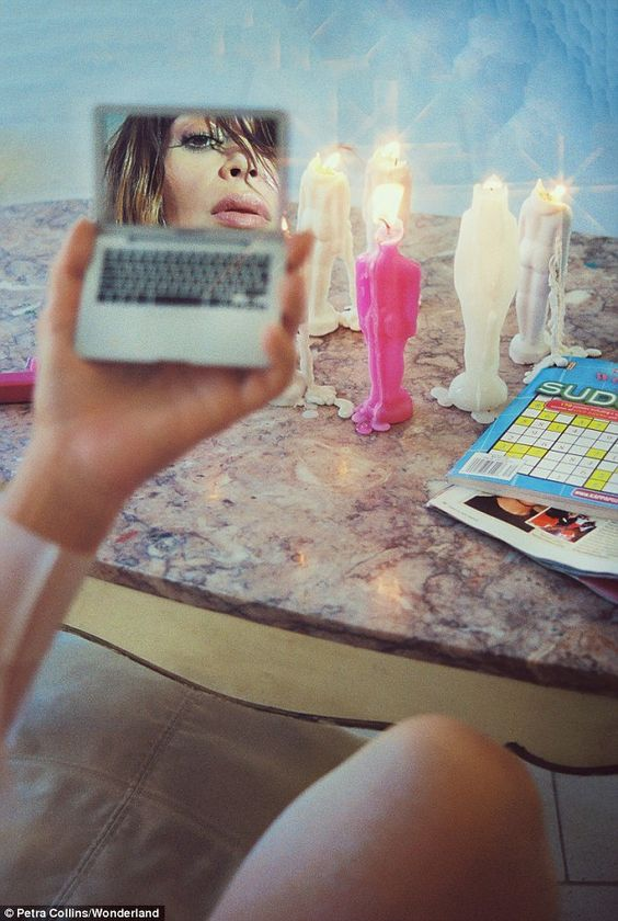 KIM K SHOT BY PETRA COLLINS - Eye see you: The siren looks in a mirror as candles burn in the background and…