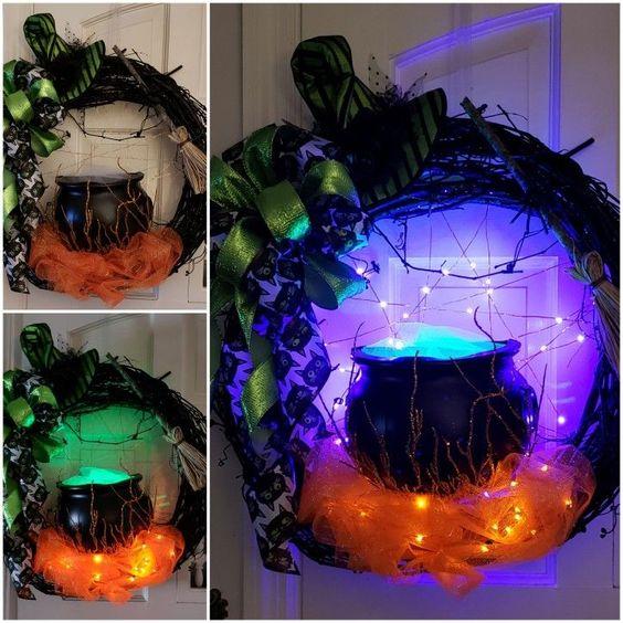Spooky witch cauldron lighted Halloween wreath