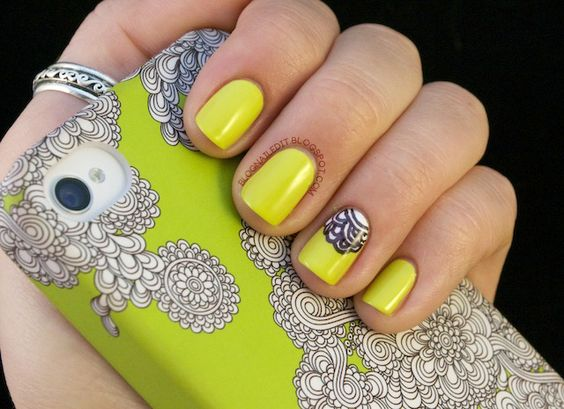 Let your cell phone cover inspire you! check out these neon green nails with accent ring finger! love love love