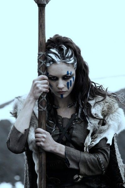 warrior woman with blue woad face paint and lye in her