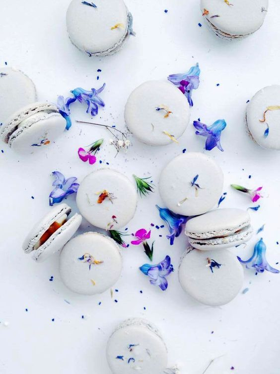 Macarons sprinkled with jewel tone confetti-like flowers: