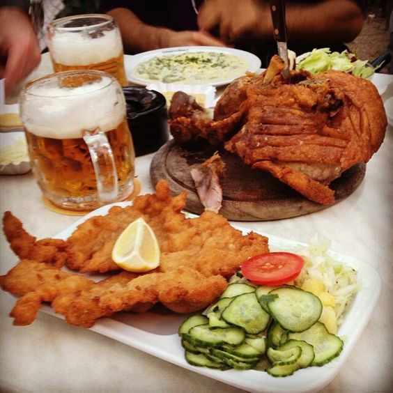 typical wiener schnitzel with cucumber and potato salad