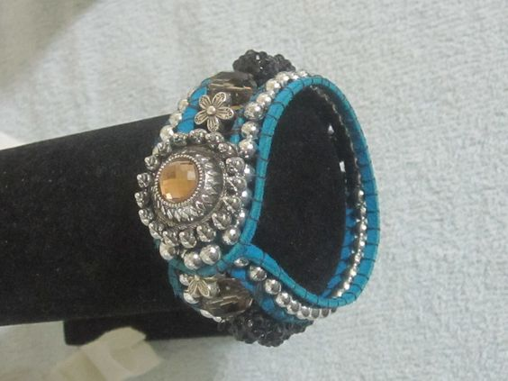 Turquoise suede with brown quart like stone.